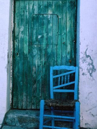 Chair in Front of a Green Door in the Village of Caceres